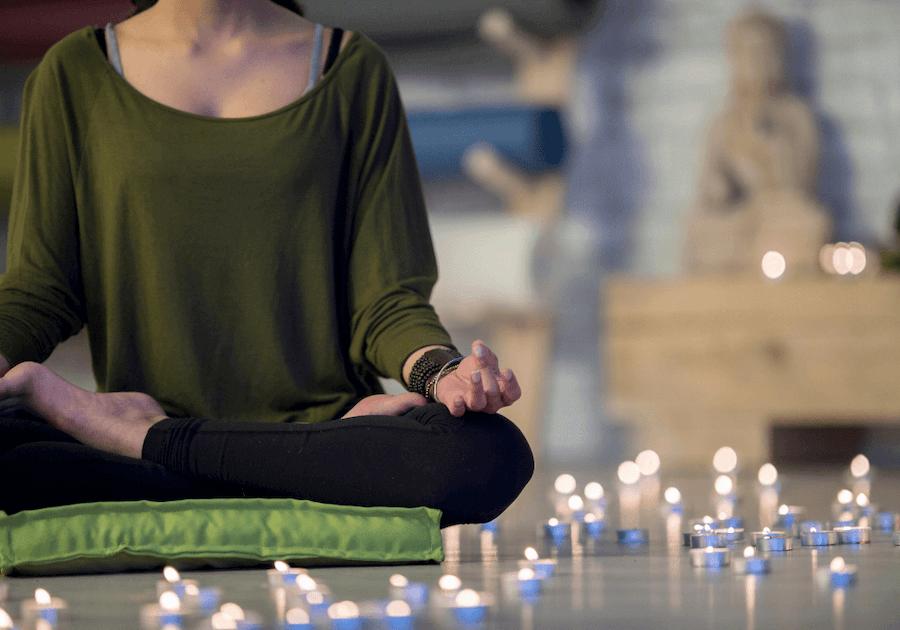 woman sitting in lotus pose best meditation cushion sets