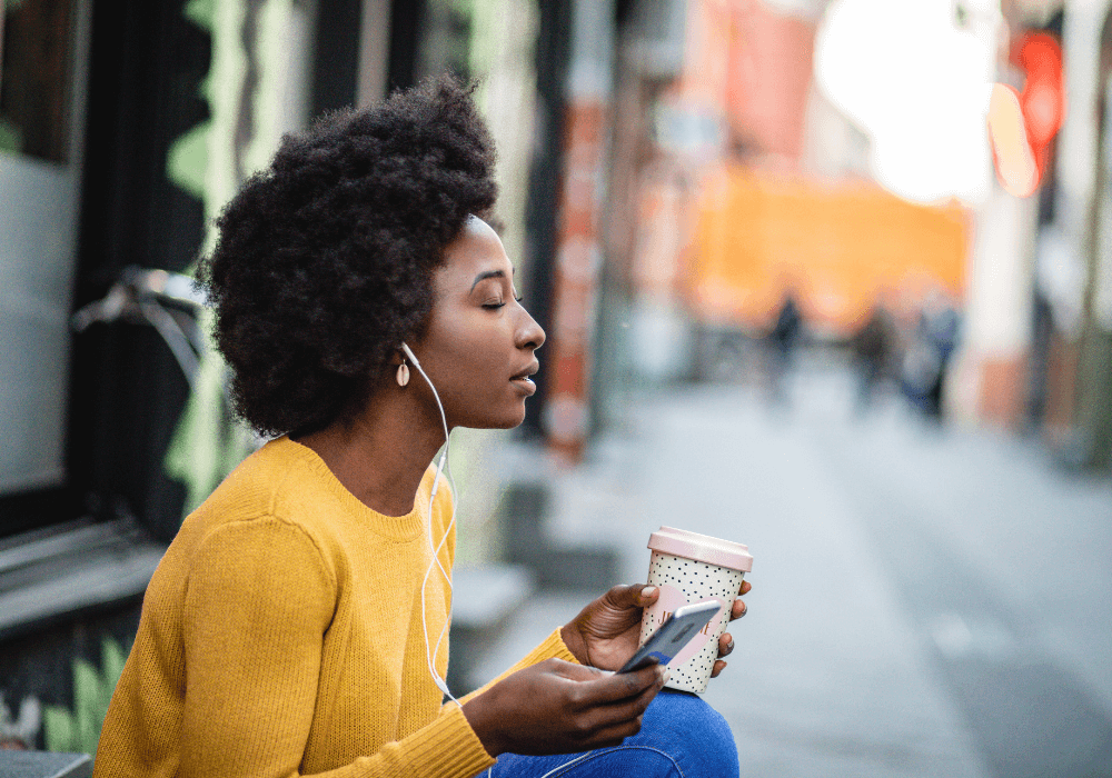 woman listening to music, mindfulness podcast