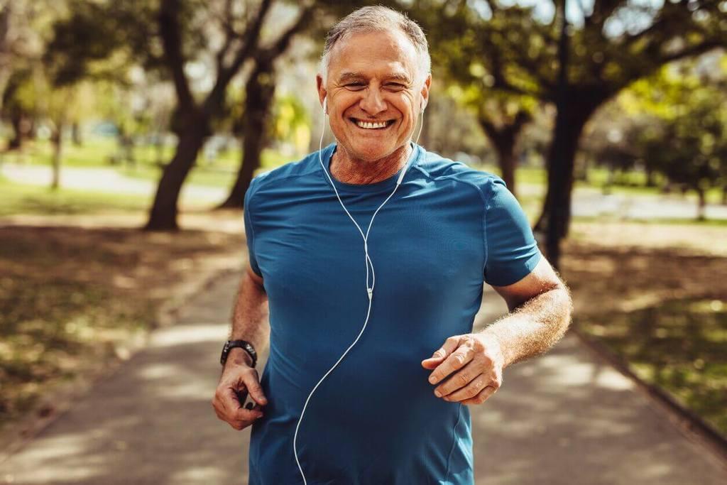 old man jogging outside adult mindfulness exercise