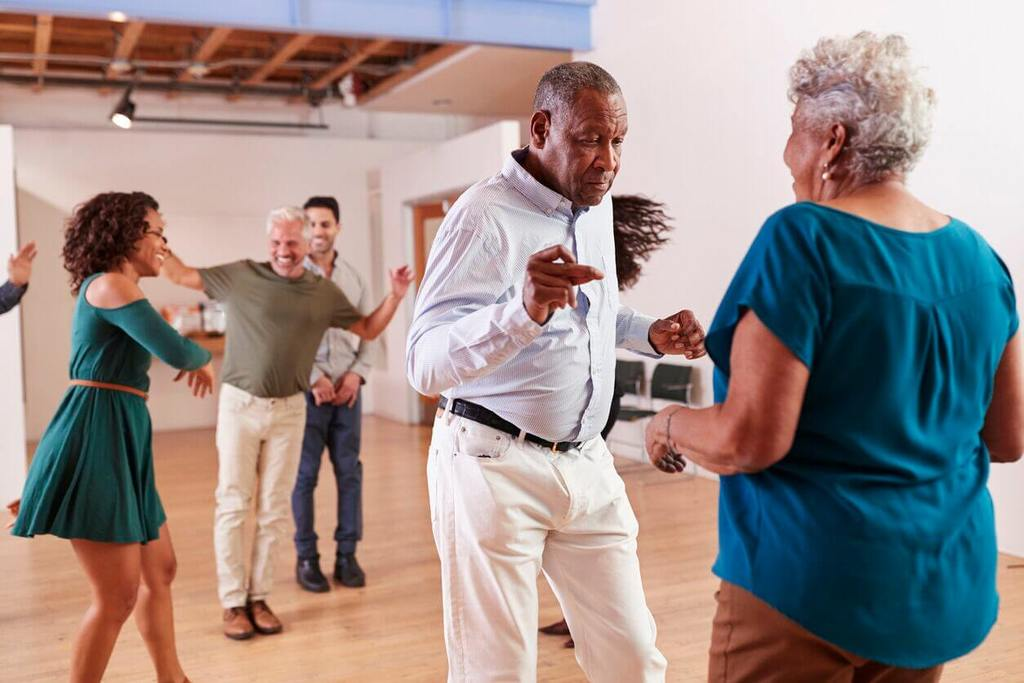 old people dancing adult mindfulness exercise