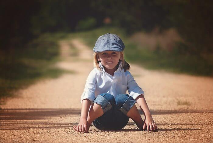 boy sitting in sand mindfulness activities for kids