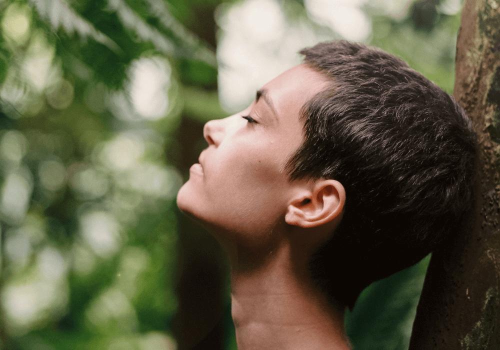 woman meditating, practicing mindfulness