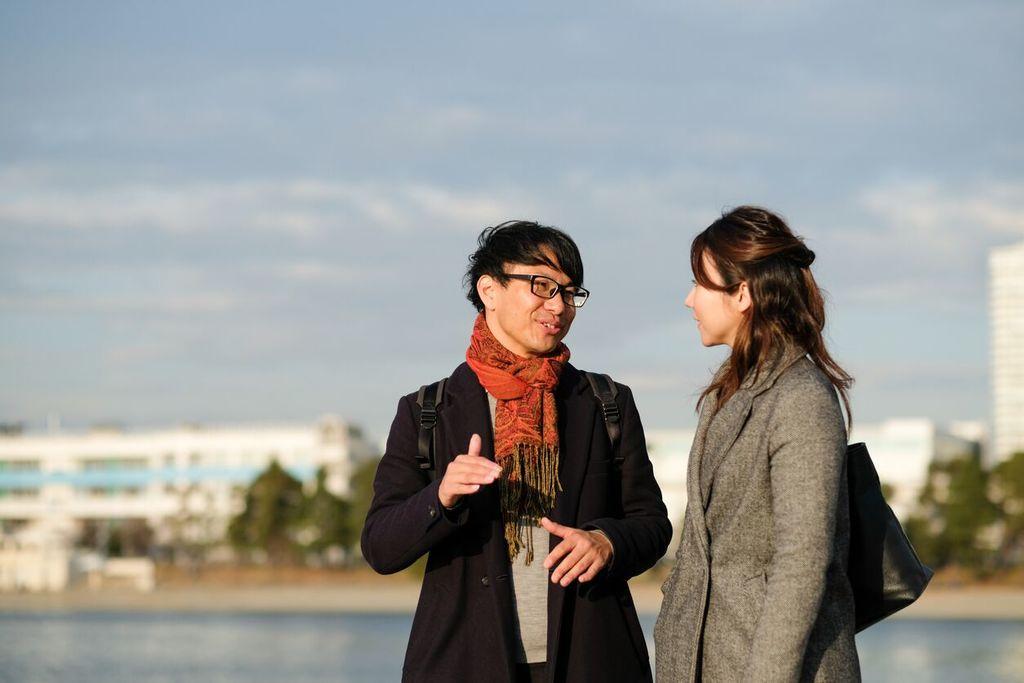 man explaining something to woman outside mindful listening