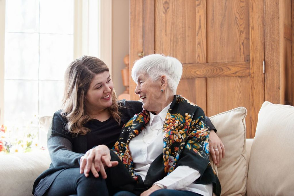 elderly woman and woman talking on the sofa mindful listening